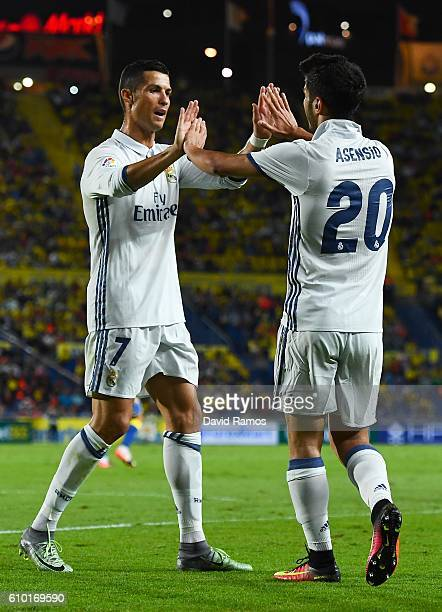 Marco Asensio of Real Madrid CF celebrates with his team mate Cristiano Ronaldo after scoring his team's first goal during the La Liga match between...