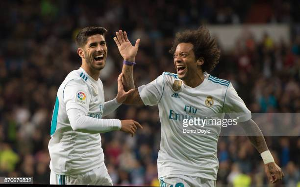 Marco Asensio of Real Madrid CF celebrates with Marcelo after scoring his team's 2nd goal during the La Liga match between Real Madrid and Las Palmas...