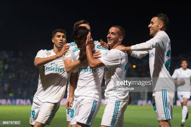 Marco Asensio of Real Madrid CF celebrates with teammates after scoring his teamÕs opening goal from a penalty kick during the Copa del Rey Round of...