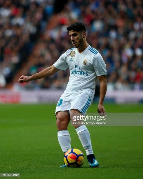 Marco Asensio of Real Madrid CF controls the ball during the La Liga match between Real Madrid CF and Sevilla FC at Estadio Santiago Bernabeu on...
