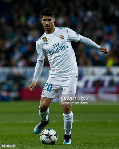 Marco Asensio of Real Madrid CF controls the ball during the UEFA Champions League group H match between Real Madrid and Borussia Dortmund at Estadio...