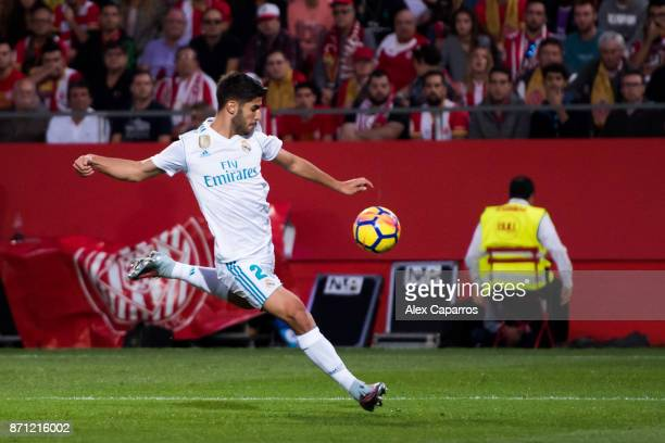 Marco Asensio of Real Madrid CF kicks the ball during the La Liga match between Girona and Real Madrid at Estadi de Montilivi on October 29 2017 in...