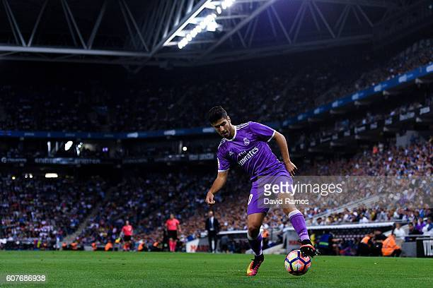 Marco Asensio of Real Madrid CF runs with the ball during the La Liga match between RCD Espanyol and Real Madrid CF at the RCDE stadium on September...