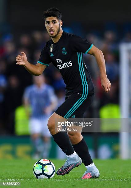 Marco Asensio of Real Madrid CF runs with the ball during the La Liga match between Real Sociedad and Real Madrid at Anoeta stadium on September 17...