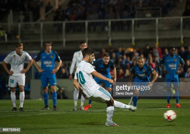Marco Asensio of Real Madrid CF scores his team's opening goal from a penalty kick during the Copa del Rey Round of 32 First Leg match between...