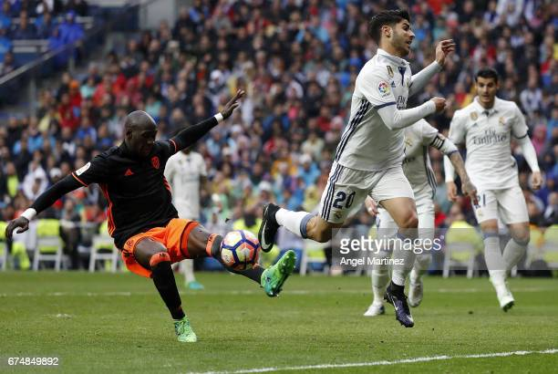 Marco Asensio of Real Madrid competes for the ball with Eliaquim Mangala of Valencia CF during the La Liga match between Real Madrid and Valencia CF...