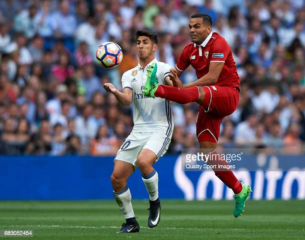 Marco Asensio of Real Madrid competes for the ball with Gabriel Mercado of Sevilla during the La Liga match between Real Madrid CF and Sevilla CF at...