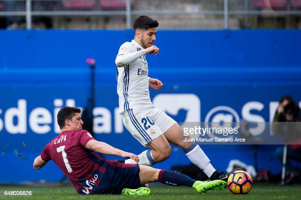 Marco Asensio of Real Madrid duels for the ball with Ander Capa of SD Eibar during the La Liga match between SD Eibar and Real Madrid at Ipurua...