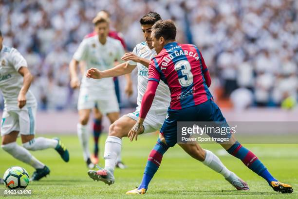 Marco Asensio of Real Madrid fights for the ball with Antonio García Aranda Tono of Levante UD during the La Liga match between Real Madrid and...