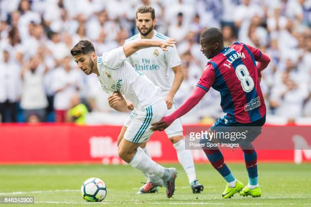 Marco Asensio of Real Madrid fights for the ball with Jefferson Lerma of Levante UD during the La Liga match between Real Madrid and Levante UD at...