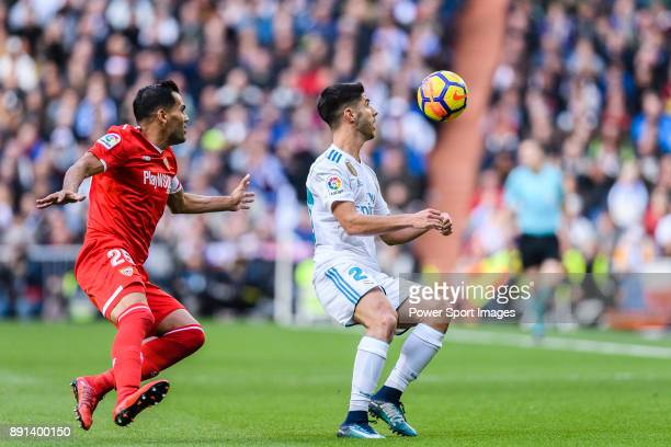 Marco Asensio of Real Madrid in action against Gabriel Mercado of Sevilla FC during the La Liga 201718 match between Real Madrid and Sevilla FC at...