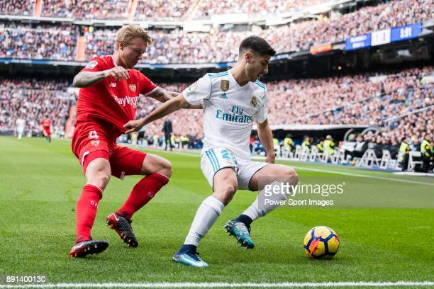 Marco Asensio of Real Madrid in action against Simon Kjaer of Sevilla FC during the La Liga 201718 match between Real Madrid and Sevilla FC at...