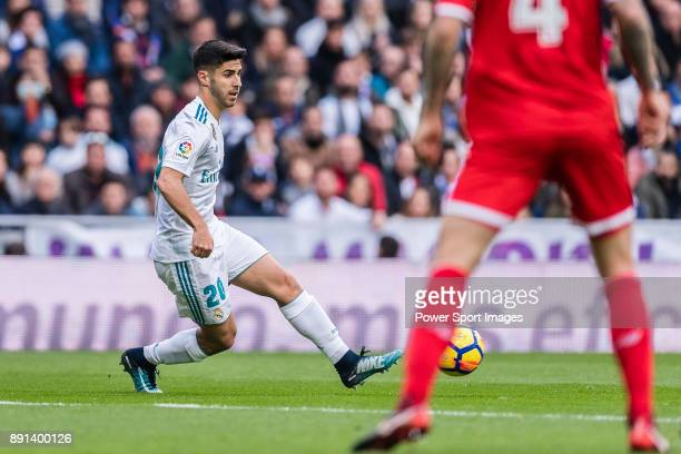 Marco Asensio of Real Madrid in action during the La Liga 201718 match between Real Madrid and Sevilla FC at Santiago Bernabeu Stadium on 09 December...