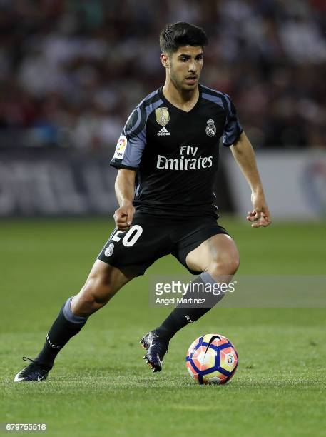 Marco Asensio of Real Madrid in action during the La Liga match between Granada CF and Real Madrid CF at Estadio Nuevo Los Carmenes on May 6 2017 in...