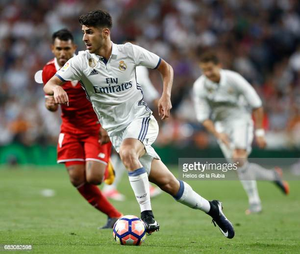 Marco Asensio of Real Madrid in action during the La Liga match between Real Madrid and Sevilla FC at Estadio Santiago Bernabeu on May 14 2017 in...
