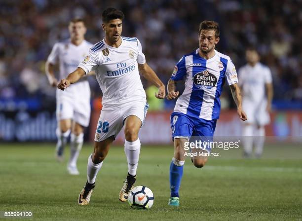 Marco Asensio of Real Madrid is chased by Fede Cartabia of Deportivo La Coruna during the La Liga match between Deportivo La Coruna and Real Madrid...