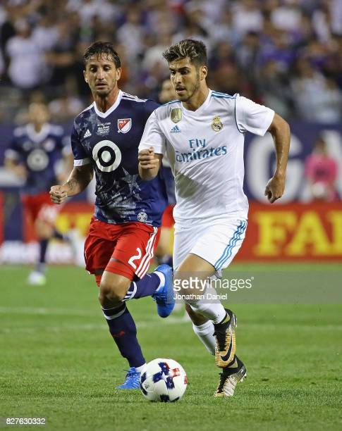 Marco Asensio of Real Madrid is chased by Hernan Grana of the MLS AllStars during the 2017 MLS All Star Game at Soldier Field on August 2 2017 in...