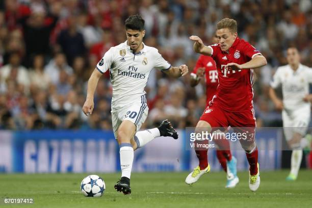 Marco Asensio of Real Madrid Joshua Kimmich of Bayern Munichduring the UEFA Champions League quarter final match between Real Madrid and Bayern...