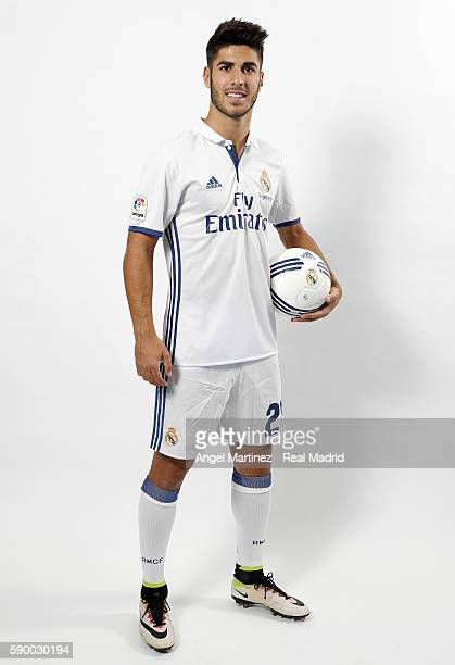 Marco Asensio of Real Madrid poses during his official presentation at Estadio Santiago Bernabeu on August 16 2016 in Madrid Spain