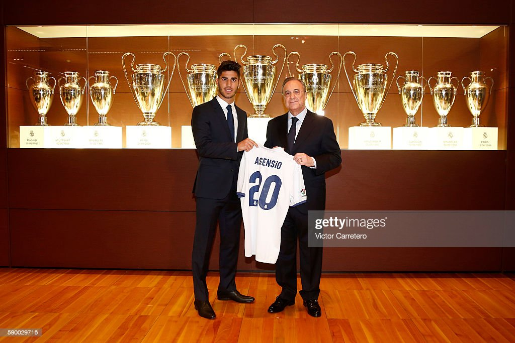 Marco Asensio of Real Madrid poses with Real Madrid president Florentino Perez during his official presentation at Estadio Santiago Bernabeu on August 16, 2016 in Madrid, Spain.