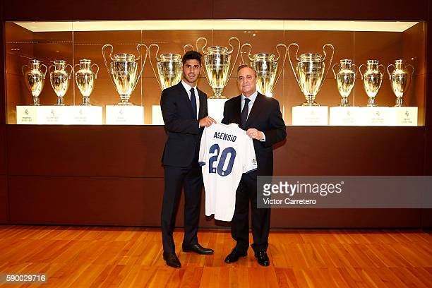 Marco Asensio of Real Madrid poses with Real Madrid president Florentino Perez during his official presentation at Estadio Santiago Bernabeu on...