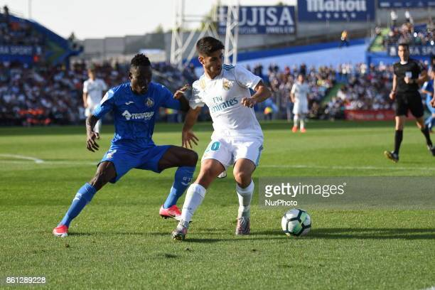 Marco Asensio of Real Madrid runs with the ball during the La Liga match between Getafe and Real Madrid at Estadio Coliseum Alfonso Perez on October...