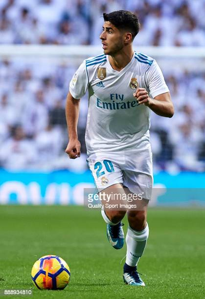 Marco Asensio of Real Madrid runs with the ball during the La Liga match between Real Madrid and Sevilla at Estadio Santiago Bernabeu on December 9...