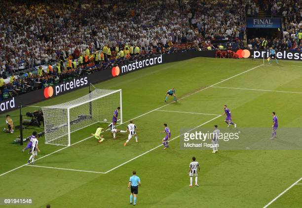 Marco Asensio of Real Madrid scores his sides fourth goal during the UEFA Champions League Final between Juventus and Real Madrid at National Stadium...