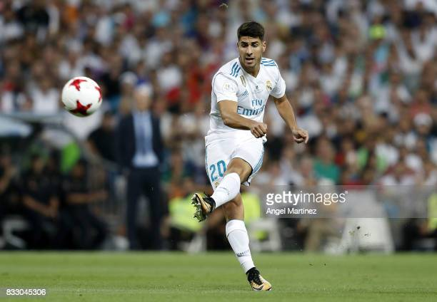 Marco Asensio of Real Madrid scores the opening goal during the Supercopa de Espana Final second leg match between Real Madrid and FC Barcelona at...