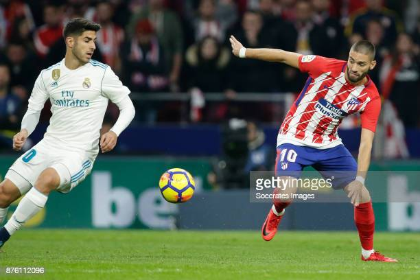 Marco Asensio of Real Madrid Yannick Carrasco of Atletico Madrid during the Spanish Primera Division match between Atletico Madrid v Real Madrid at...