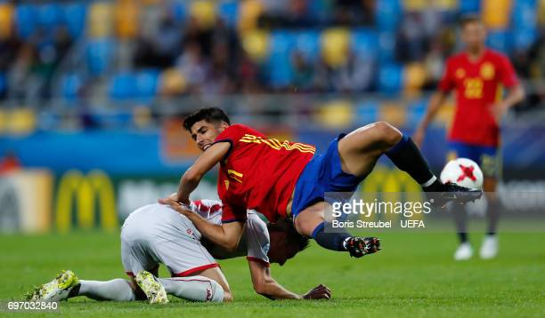 Marco Asensio of Spain and David Babunski of FYR Macedonia fights for the ball during the UEFA European Under21 Championship match between Spain and...