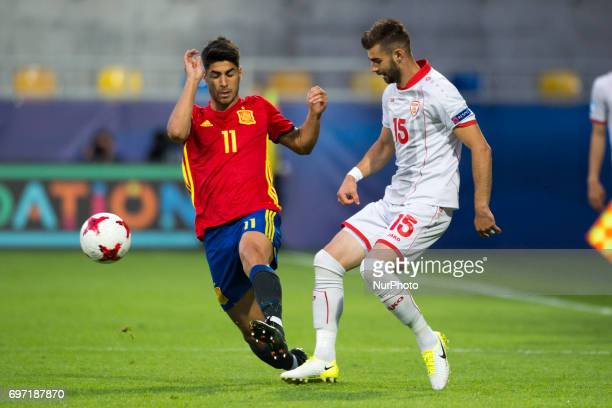 Marco Asensio of Spain and Egzon Bejtulal of Macedonia fight for the ball during the UEFA Under 21 Championship Group B match between Spain and FYR...