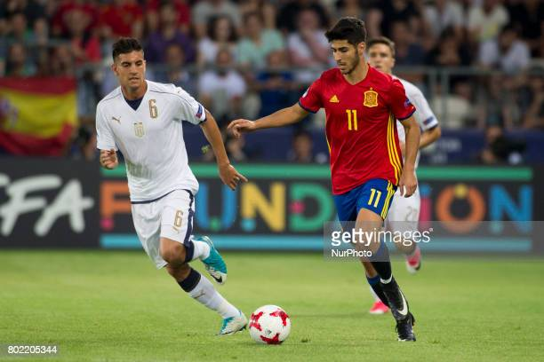 Marco Asensio of Spain and Lorenzo Pellegrini of Italy fight for the ball during the UEFA European Under21 Championship SemiFinal match between Spain...