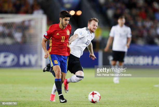 Marco Asensio of Spain and Maximilian Arnold of Germany during the UEFA U21 Final match between Germany and Spain at Krakow Stadium on June 30 2017...