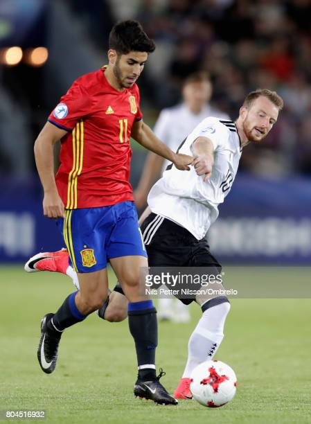Marco Asensio of Spain and Maximilian Arnold of Germany in action during the UEFA European Under21 Championship Final between Germany and Spain at...