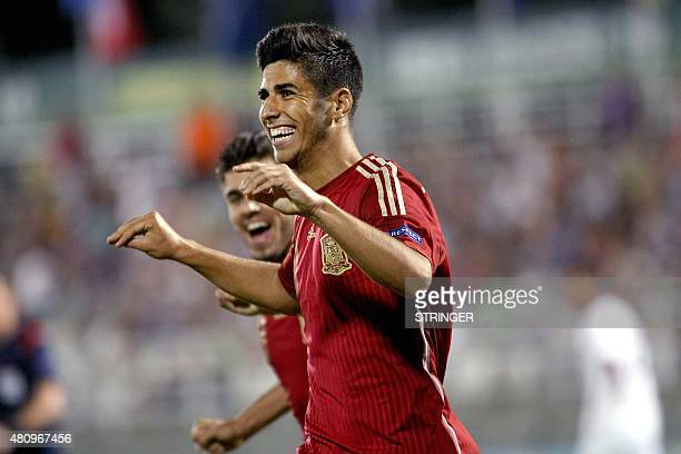Marco Asensio of Spain celebrates after scoring during the UEFA 2015 European U19 Championship semifinal match between France and Spain at Municipal...