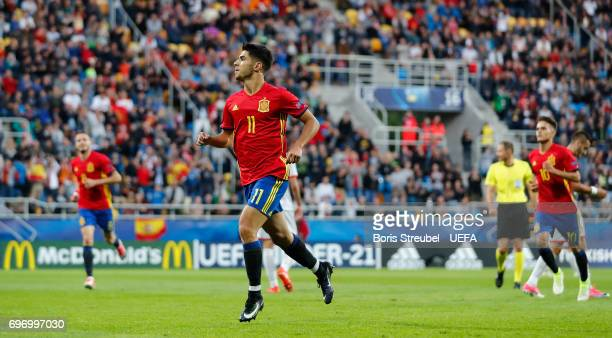 Marco Asensio of Spain celebrates with team mates after scoring his team's second goal during the UEFA European Under21 Championship match between...