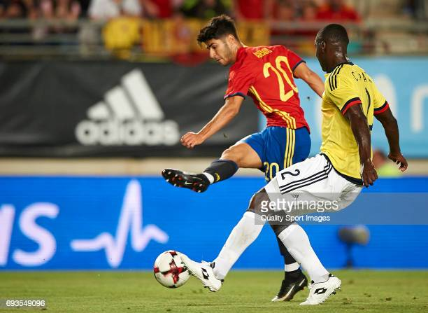 Marco Asensio of Spain competes for the ball with Cristian Zapata of Colombia during the international friendly match between Spain and Colombia at...