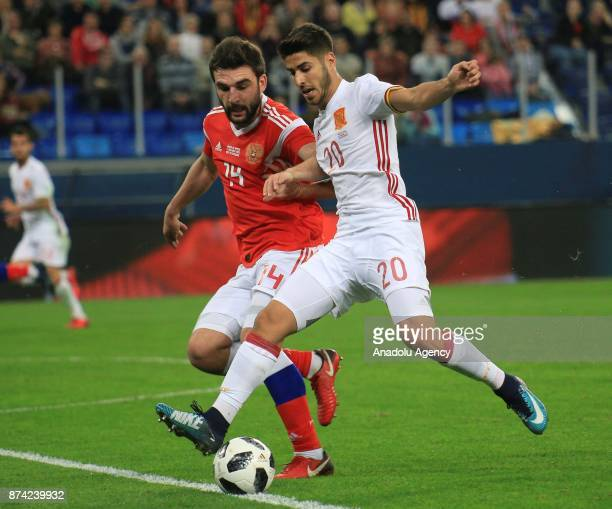 Marco Asensio of Spain in action against Georgi Dzhikia of Russia during an international friendly football match between Russia and Spain at...