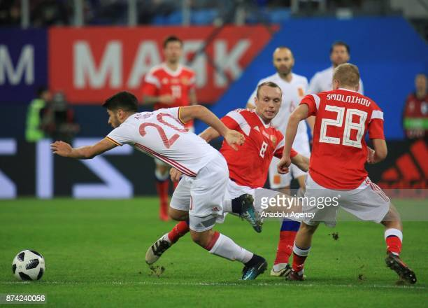 Marco Asensio of Spain in action against Igor Smolnikov and Denis Glushakov of Russia during an international friendly football match between Russia...