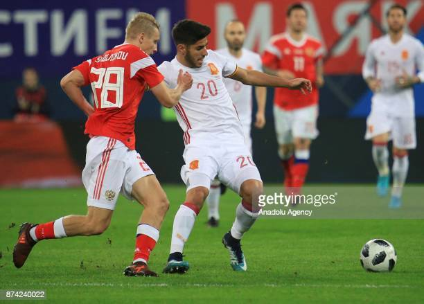 Marco Asensio of Spain in action against Igor Smolnikov of Russia during an international friendly football match between Russia and Spain at...