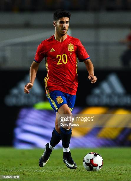 Marco Asensio of Spain runs with the ball during a friendly match between Spain and Colombia at La Nueva Condomina stadium on June 7 2017 in Murcia...