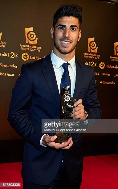 Marco Asensio poses with the Best Newcomer in La liga Santander 2015/16 Trophy during the LFP Soccer Awards Gala 2016 at Palacio de Congresos on...