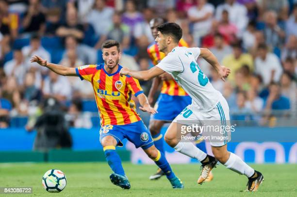 Marco Asensio Willemsen of Real Madrid battles for the ball with Jose Luis Gaya Pena of Valencia CF during their La Liga 201718 match between Real...