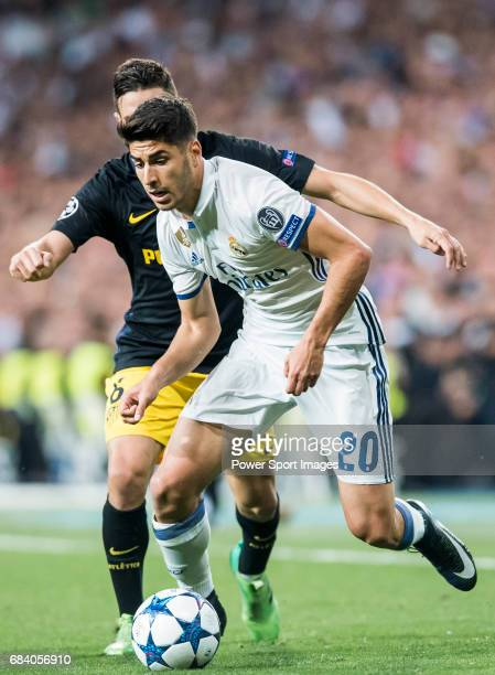 Marco Asensio Willemsen of Real Madrid battles for the ball with Jorge Resurreccion Merodio Koke of Atletico de Madrid during their 201617 UEFA...