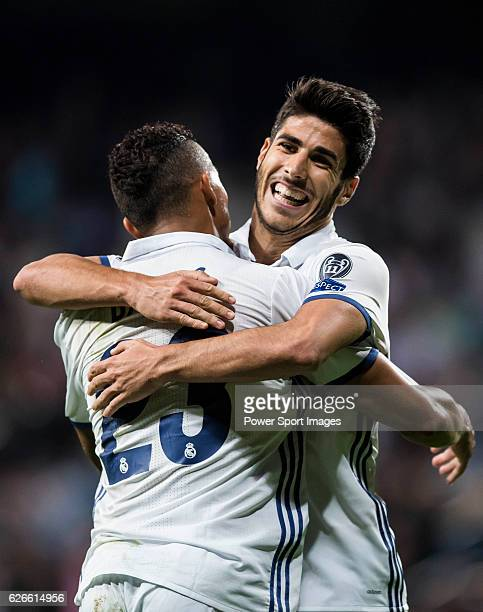 Marco Asensio Willemsen of Real Madrid celebrates with teammate Danielo Luiz Da Silva during the 201617 UEFA Champions League match between Real...
