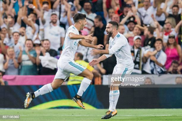 MADRID SPAIN AUGUST 16 Marco Asensio Willemsen of Real Madrid celebrates with teammate Daniel Carvajal Ramos during their Supercopa de Espana Final...
