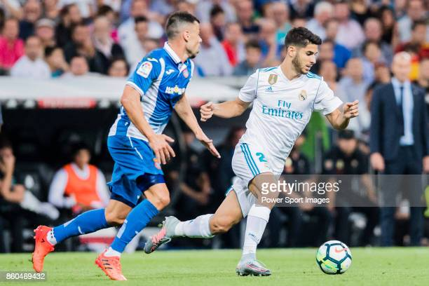 Marco Asensio Willemsen of Real Madrid fights for the ball with Javi Fuego of RCD Espanyol during the La Liga 201718 match between Real Madrid and...