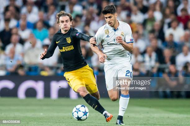 Marco Asensio Willemsen of Real Madrid fights for the ball with Antoine Griezmann of Atletico de Madrid during their 201617 UEFA Champions League...