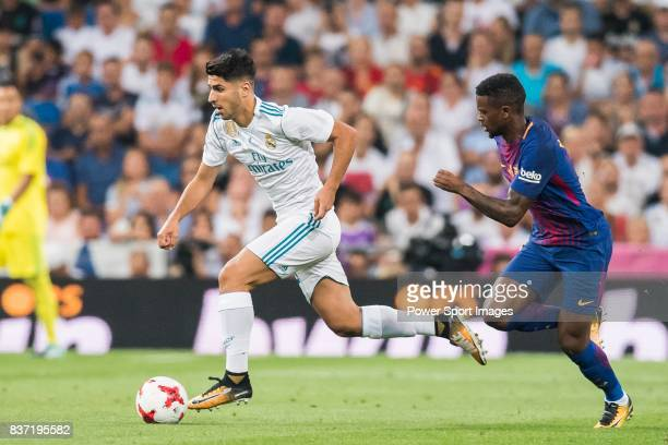 MADRID SPAIN AUGUST 16 Marco Asensio Willemsen of Real Madrid fights for the ball with Nelson Cabral Semedo of FC Barcelona during their Supercopa de...